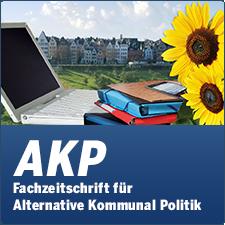 AKP - Fachzeitschrift für Alternative Kommunalpolitik - Bild mit Kommune im Hintergrund, Laptop, Akten, Smartphone und Sonnenblumen im Vordergrund
